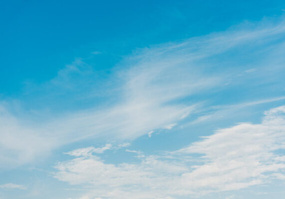 white clouds on blue sky with copy space