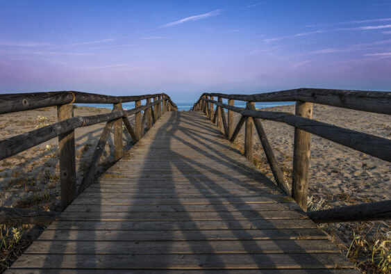 Wooden path to the beach. Morning sky